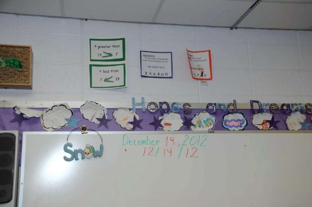 This December 2012 photo released by the Connecticut State Police on Friday shows the scene inside Victoria Soto's classroom at Sandy Hook Elementary School in Newtown, Conn.