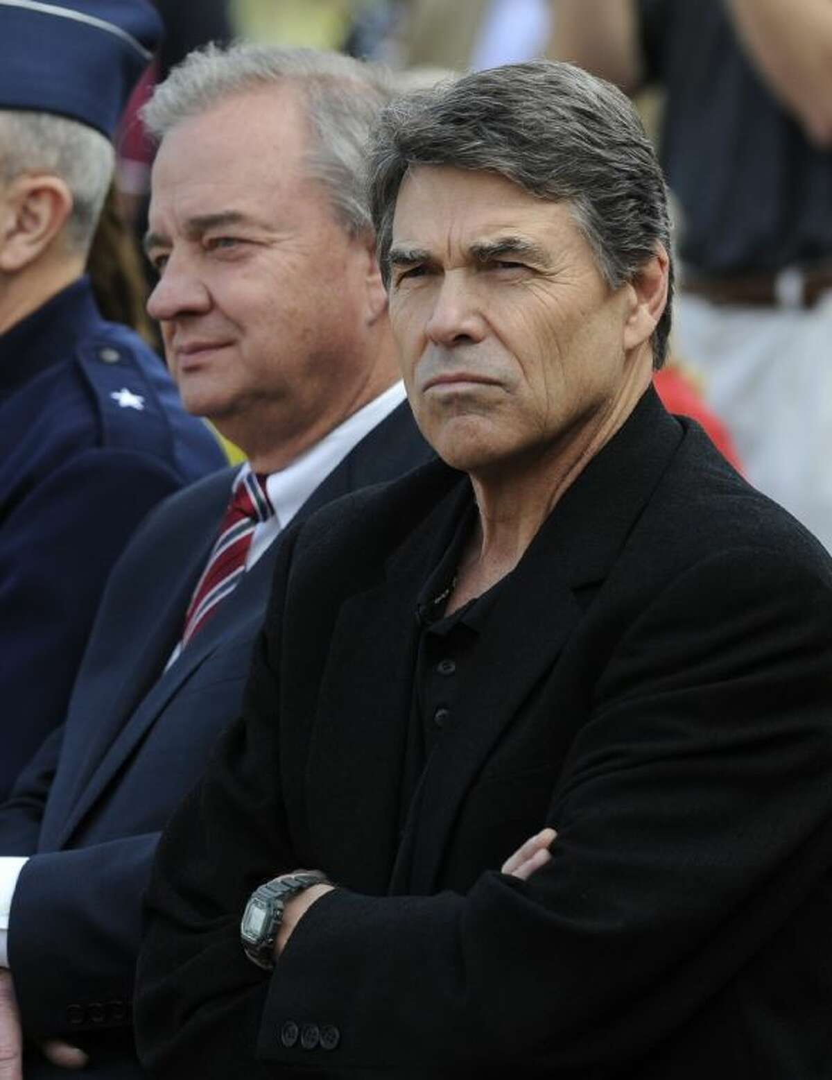 Texas Gov. Rick Perry and Texas A&M chancellor John Sharp attend ceremonies marking the reactivation of their old Corps of Cadets squadron last week in College Station. Perry spoke out against President Obama's plan to curb gun violence Wednesday.