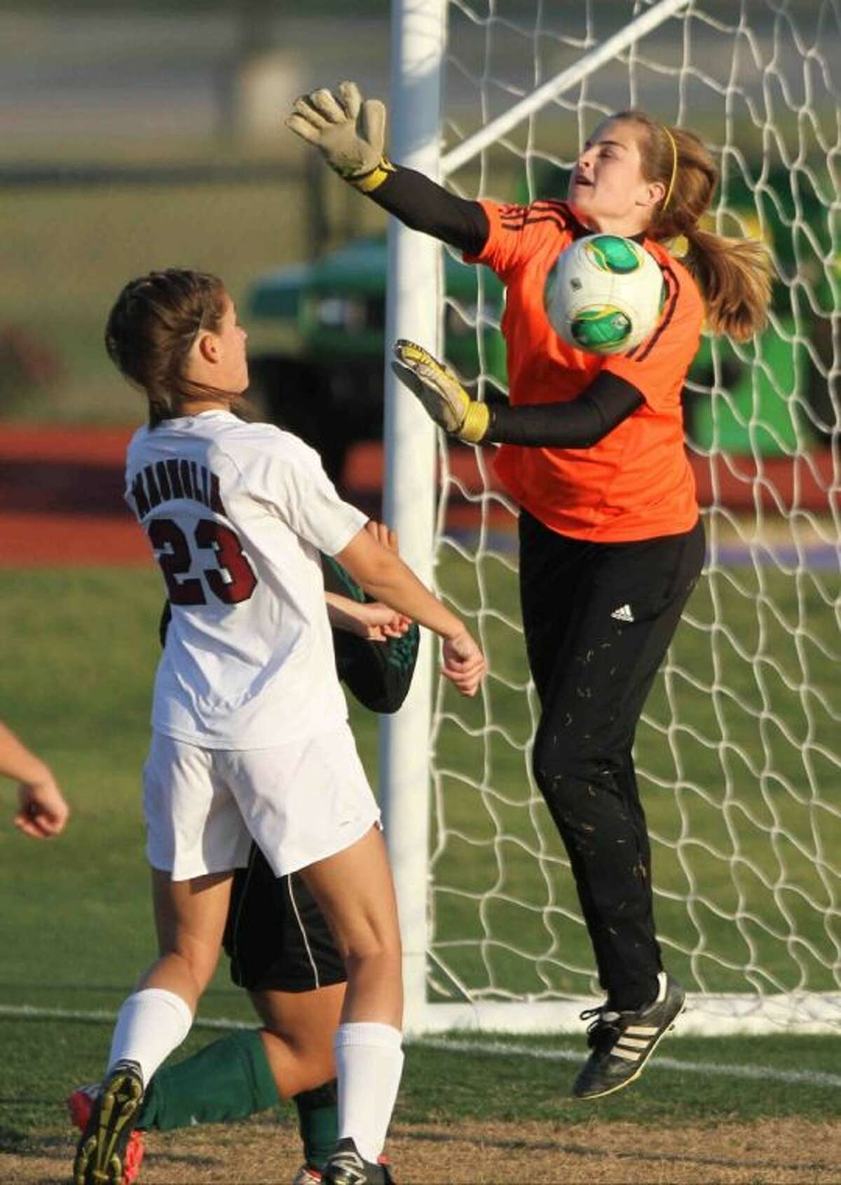 Magnolia goalkeeper Sarah Hubble deflects a shot during a Region III-4A bi-district playoff match against Huntsville on Tuesday in Willis. To view or purchase this photo and others like it, visit HCNpics.com.