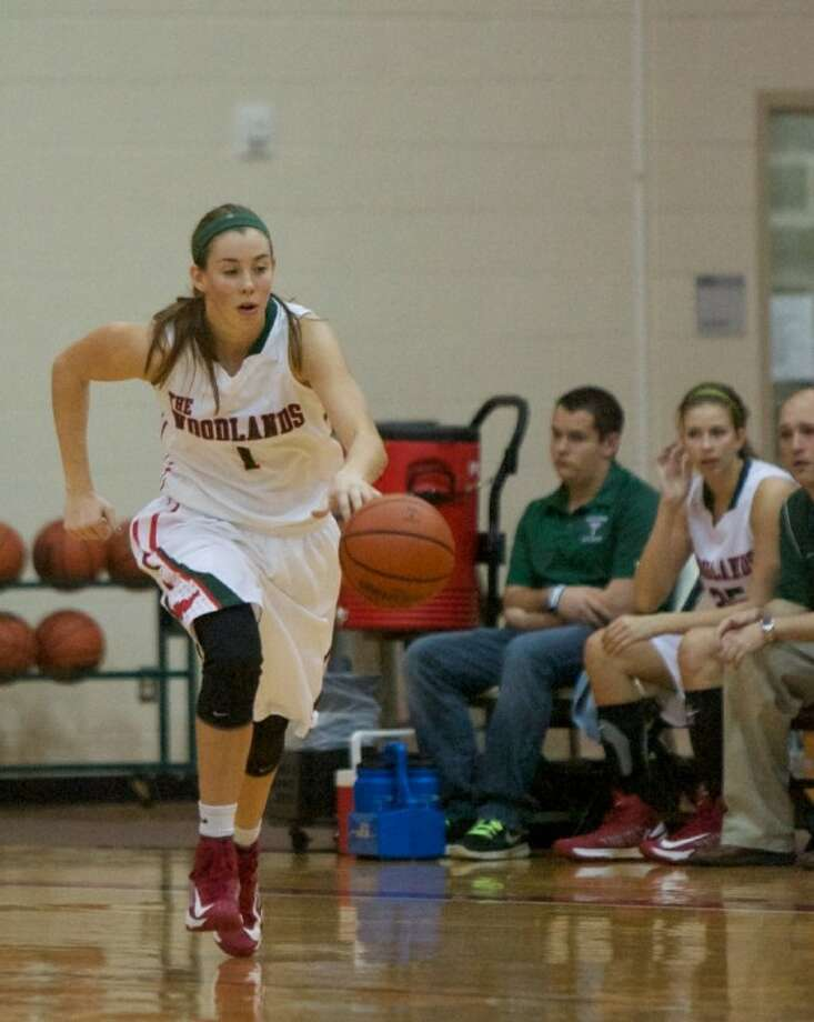 The Woodlands' Nicole Iademarco dribbles downcourt during a game last season. Photo: Staff Photo By Eric Swist