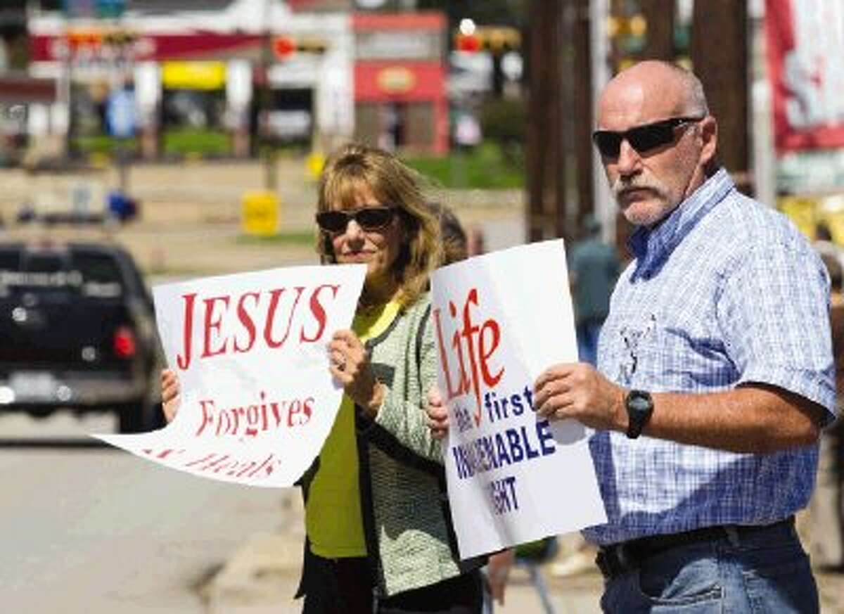 Danny Freeman and Sue Allegar hold up pro-life sign during the Life Chain, a pro-life movement, Sunday afternoon. People lined Frazier Street in Conroe holding up pro-life signs. Go to HCNPics.com to view and purchase this photo, and others like it.