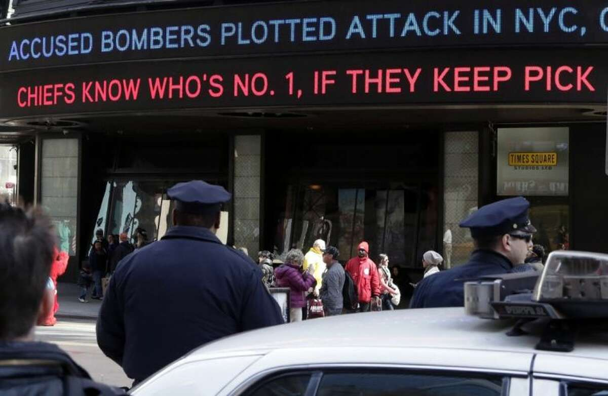 News headlines circle a building in New York's Times Square Thursday. The Boston Marathon bombing suspects had planned to blow up their remaining explosives in New York's Times Square, officials said Thursday.