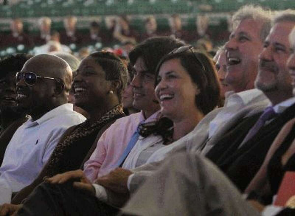Members of the Mitchell family and their friends laugh as Todd Mitchell recalls memories of his father, George Mitchell, during a celebration of his life at the Cynthia Woods Mitchell Pavilion Thursday. To view more photos of the event, go to HCNPics.com.
