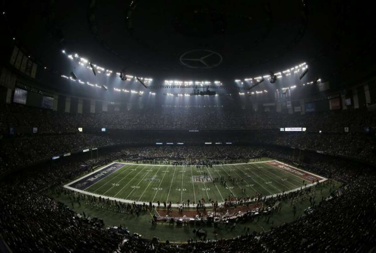 Fans and members of the Baltimore Ravens and San Francisco 49ers wait for power to return in the Superdome during an outage in the second half of the NFL Super Bowl XLVII football game, Sunday, Feb. 3, 2013, in New Orleans.