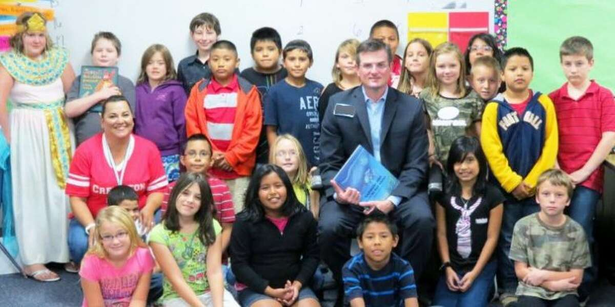 Students from Creighton pose with a guest reader, State Representative Brandon Creighton.