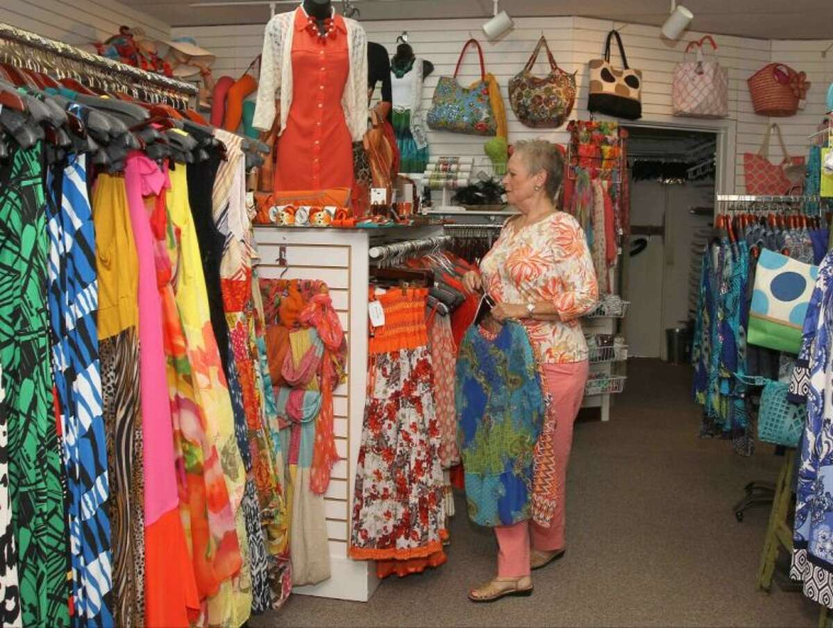 Pat Adams picks out jewelry at Silks n' Twigs in Conroe Tuesday.