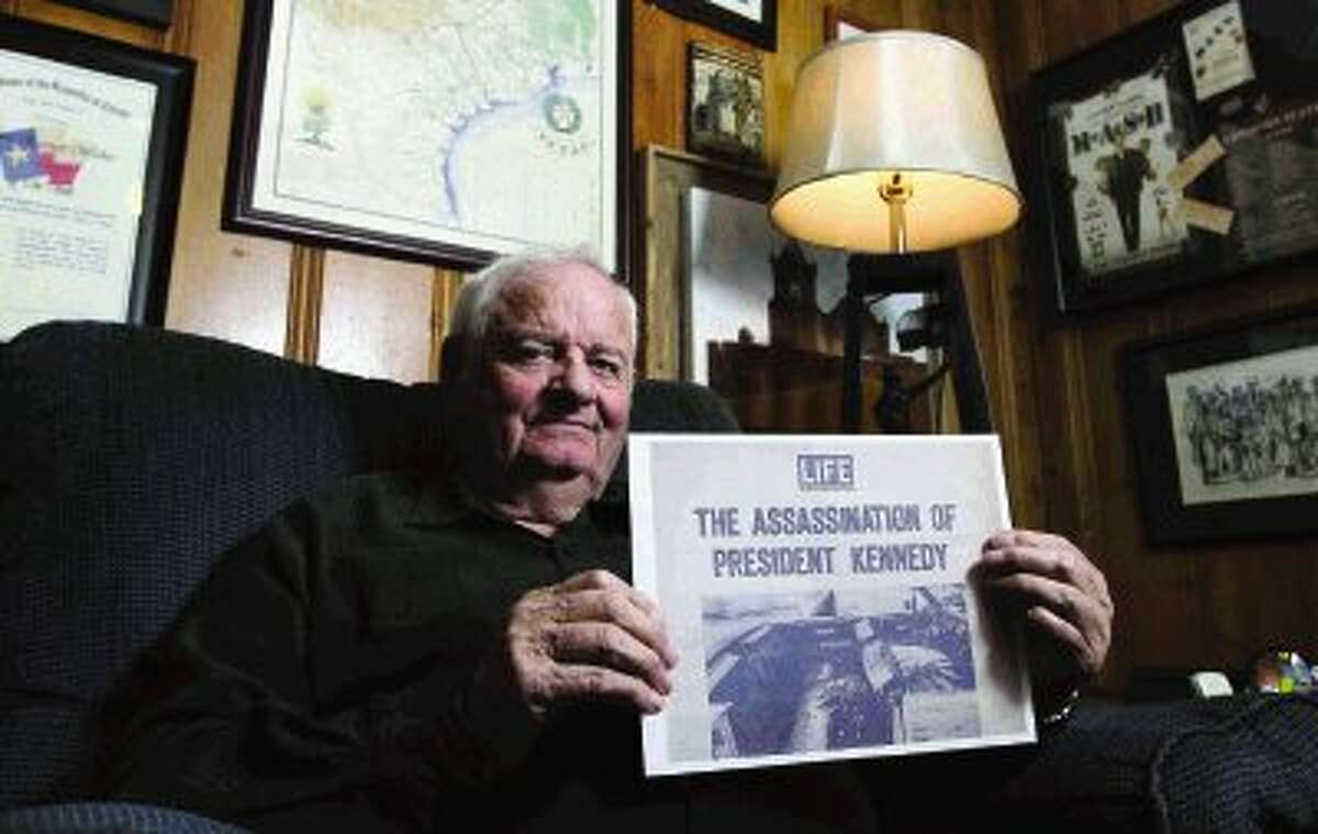 Conroe resident Jim Walker displays a replica copy of an issue of a historic LIFE magazine from 1963. Walker's own photos will be displayed at the Montgomery County Memorial Library Systems - Central Branch, in Conroe, from Nov. 14 through Dec. 30.