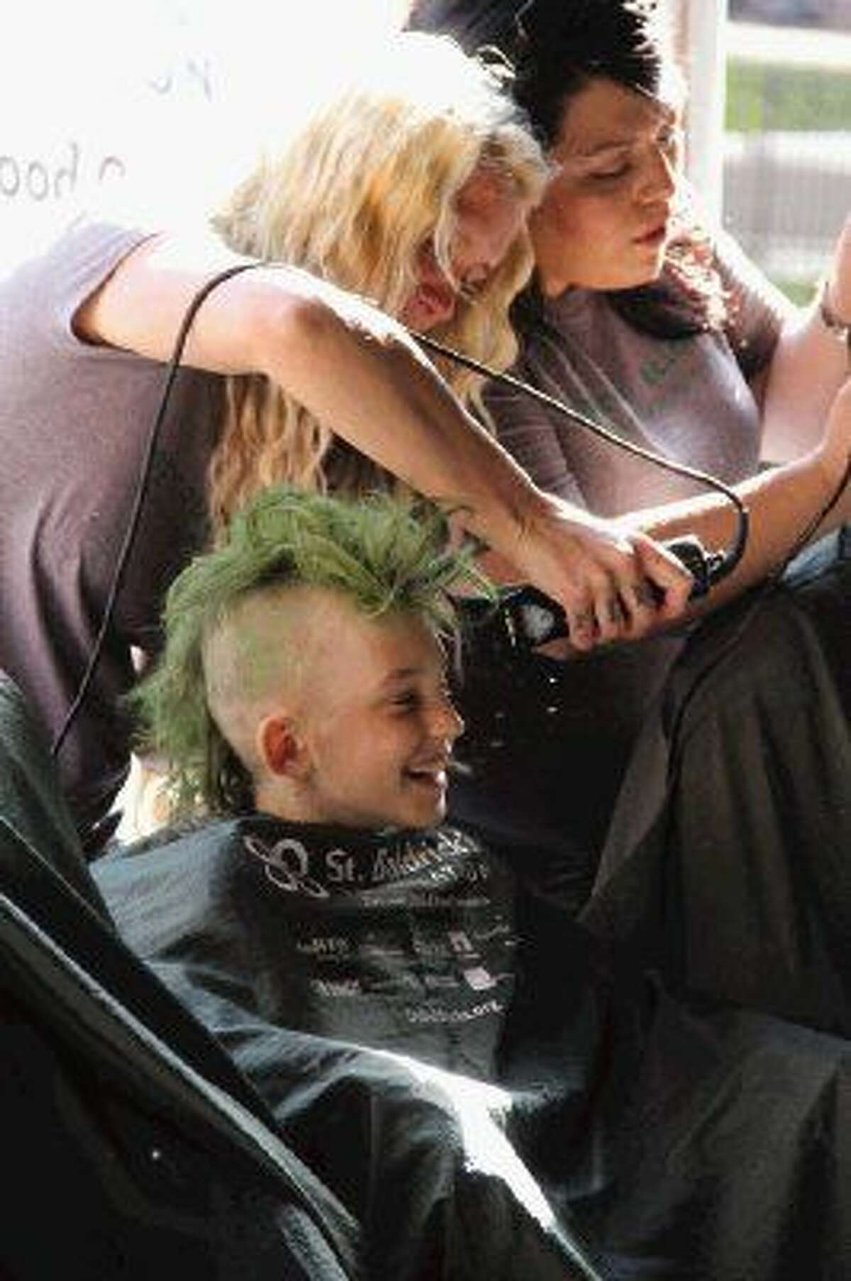 In this 2013 file photo, Devin Nemetz, 10, a fourth-grader at Lamar Elementary, wears a big grin as he participates in his fifth St. Baldrick's Day shave Sunday at the The Goose's Acre in The Woodlands.