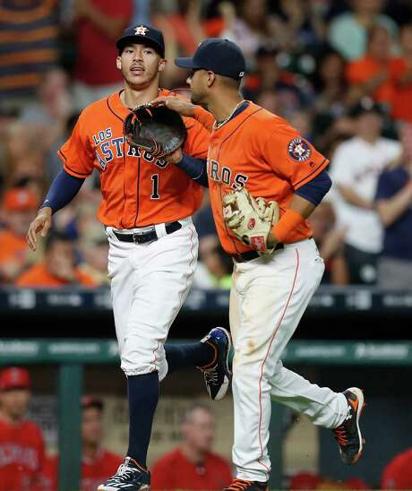 Shortstop Carlos Correa, left, celebrates a defensive gem with Yulieski Gurriel on Saturday night. Photo: Karen Warren, Staff Photographer / 2016 Houston Chronicle