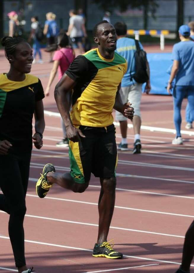 Jamaica's Usain Bolt jogs during a national team training session on Thursday ahead of the IAAF World Championships in Moscow. Photo: Ivan Sekretarev