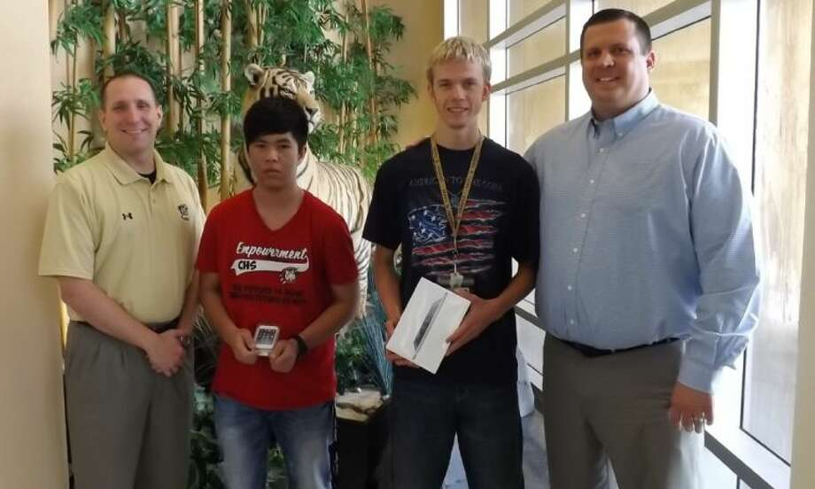 """The Conroe Noon Lions Club sponsored a """"perfect attendance"""" contest at Conroe High School during the last nine weeks of school and gave away an iPod touch and iPad mini as grand prizes. Pictured (left to right): Dr. Curtis Null, CHS principal, Vien Pham, Jacob McCauley and Warner Phelps, CNLC Leo Club liaison."""