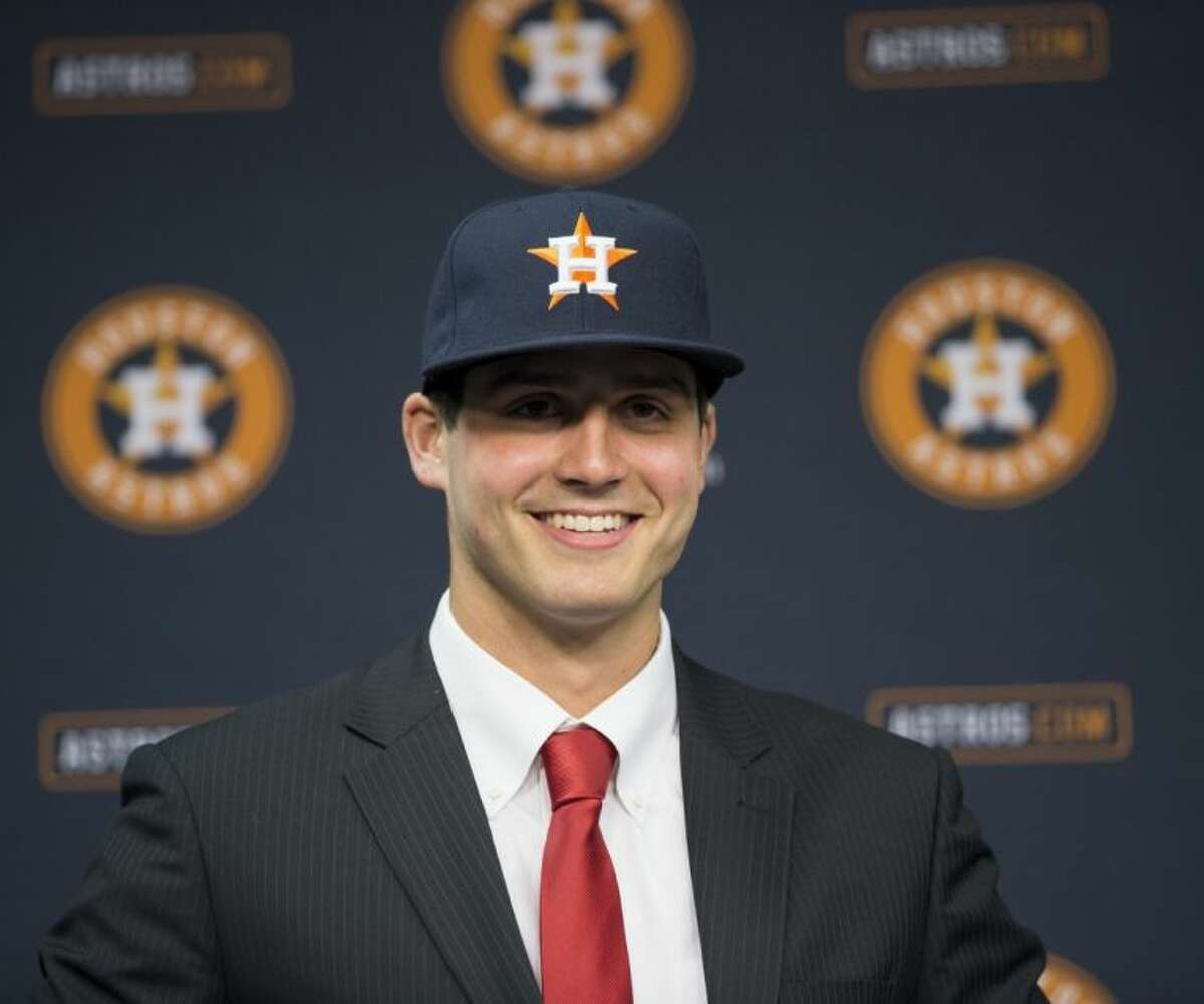 Newly signed Houston Astros pitcher Mark Appel smiles during a news conference to announce his signing on Wednesday in Houston. Appel was selected with the first overall pick in the MLB First-Year Player Draft.