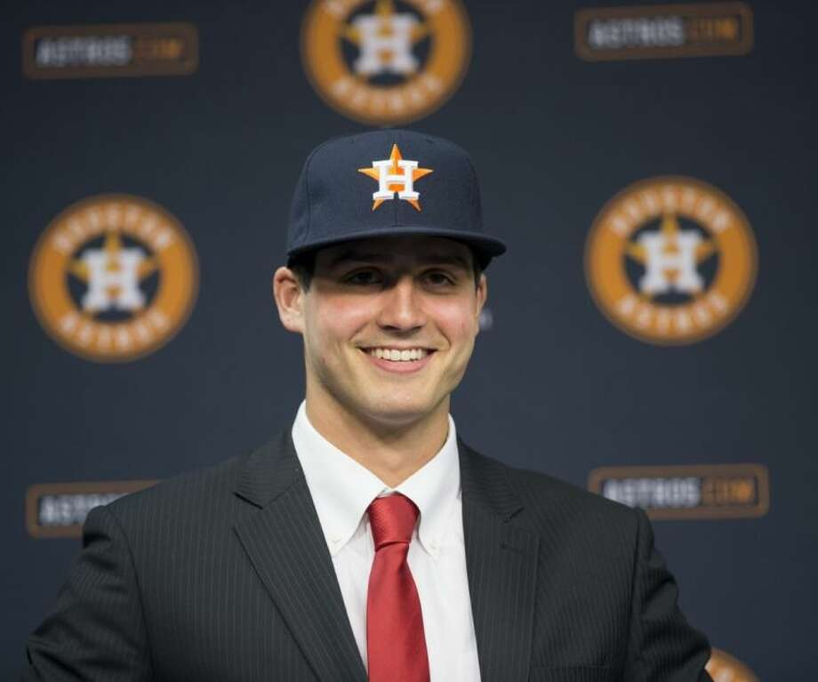 Newly signed Houston Astros pitcher Mark Appel smiles during a news conference to announce his signing on Wednesday in Houston. Appel was selected with the first overall pick in the MLB First-Year Player Draft. Photo: David J. Phillip