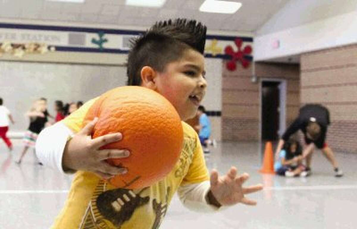 """Nava Yahir looks to tag classmates for a game during a physical education class at Anderson Elementary in Conroe Thursday. The school's """"Healthy Me!"""" program, which promotes physical education and healthy habits, was awarded a $2,000 grant from the Montgomery County United Way and Healthy Living Alliance to help students learn healthy habits."""