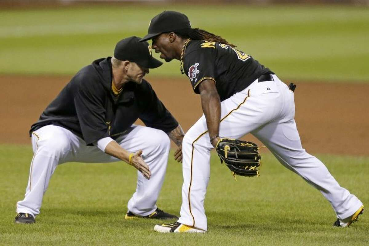 Pittsburgh Pirates center fielder Andrew McCutchen celebrates with A.J. Burnett after the Pirates' 5-4 win over the St. Louis Cardinals on July 31 in Pittsburgh.