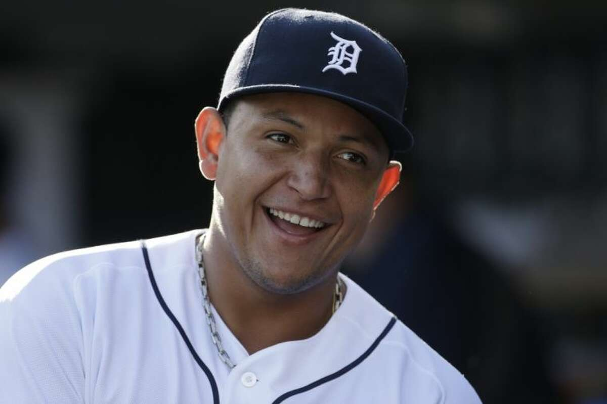 Detroit Tigers third baseman Miguel Cabrera smiles in the dugout before a baseball game against the Texas Rangers on July 13 in Detroit.