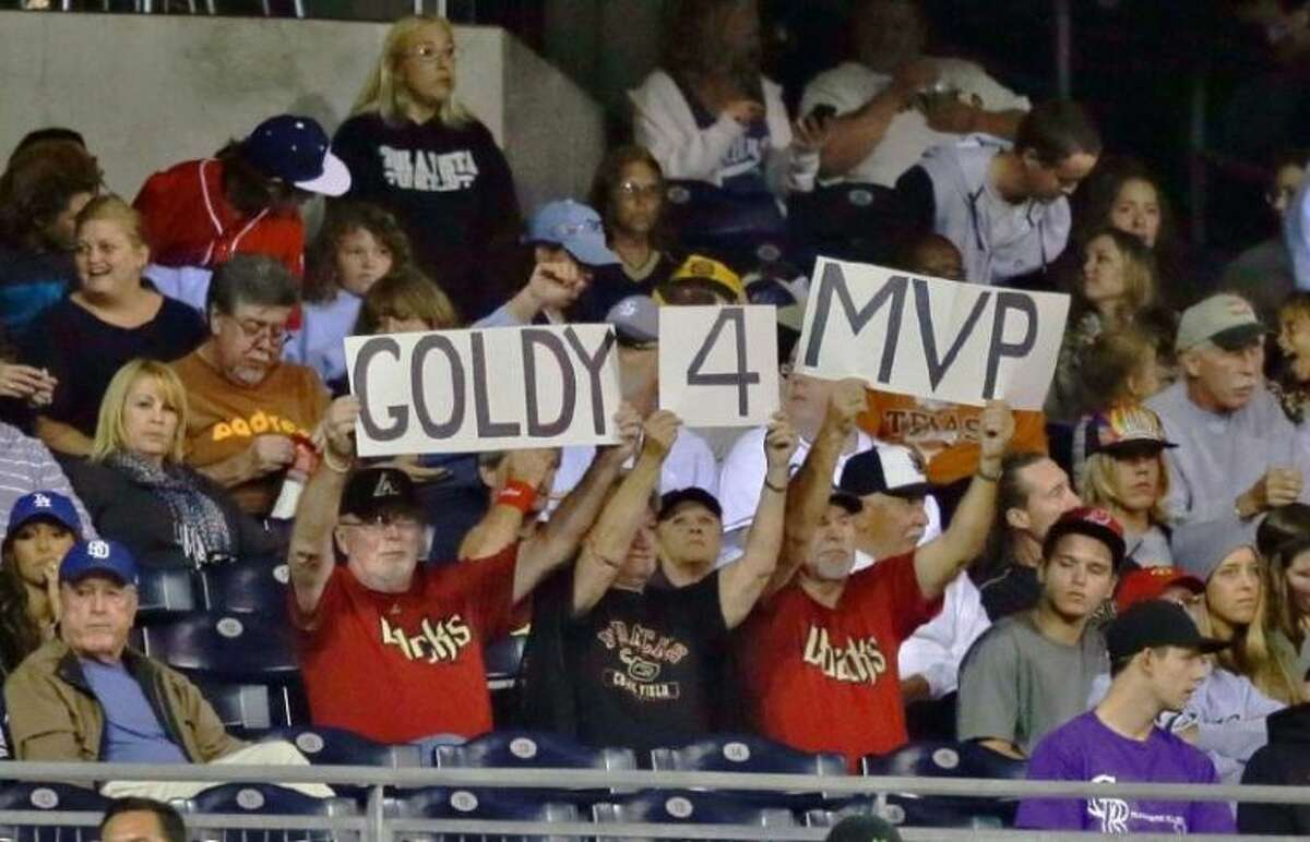 Arizona Diamondbacks fans hold up a sign supporting first baseman Paul Goldschmidt for National League Most Valuable Player on Sept. 25 in San Diego.