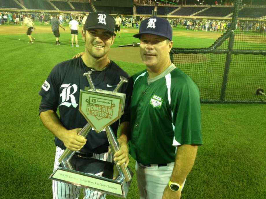 Former College Park star Michael Aquino, left, won the College Home Run Derby on Wednesday night with his former Cavaliers coach Jason Washburn pitching.