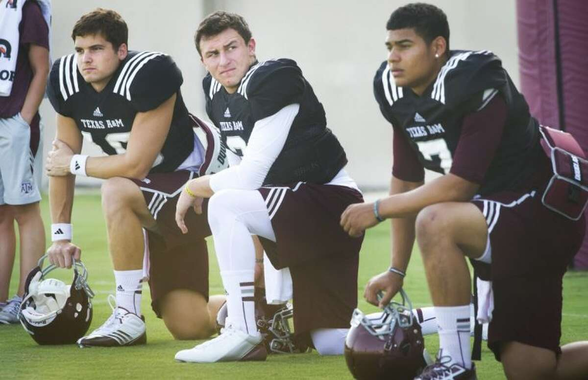 Texas A&M quarterback Johnny Manziel is suspended for the first half of today's game against Rice and will be replaced by either Matt Joekel, left, or Kenny Hill in the starting lineup.