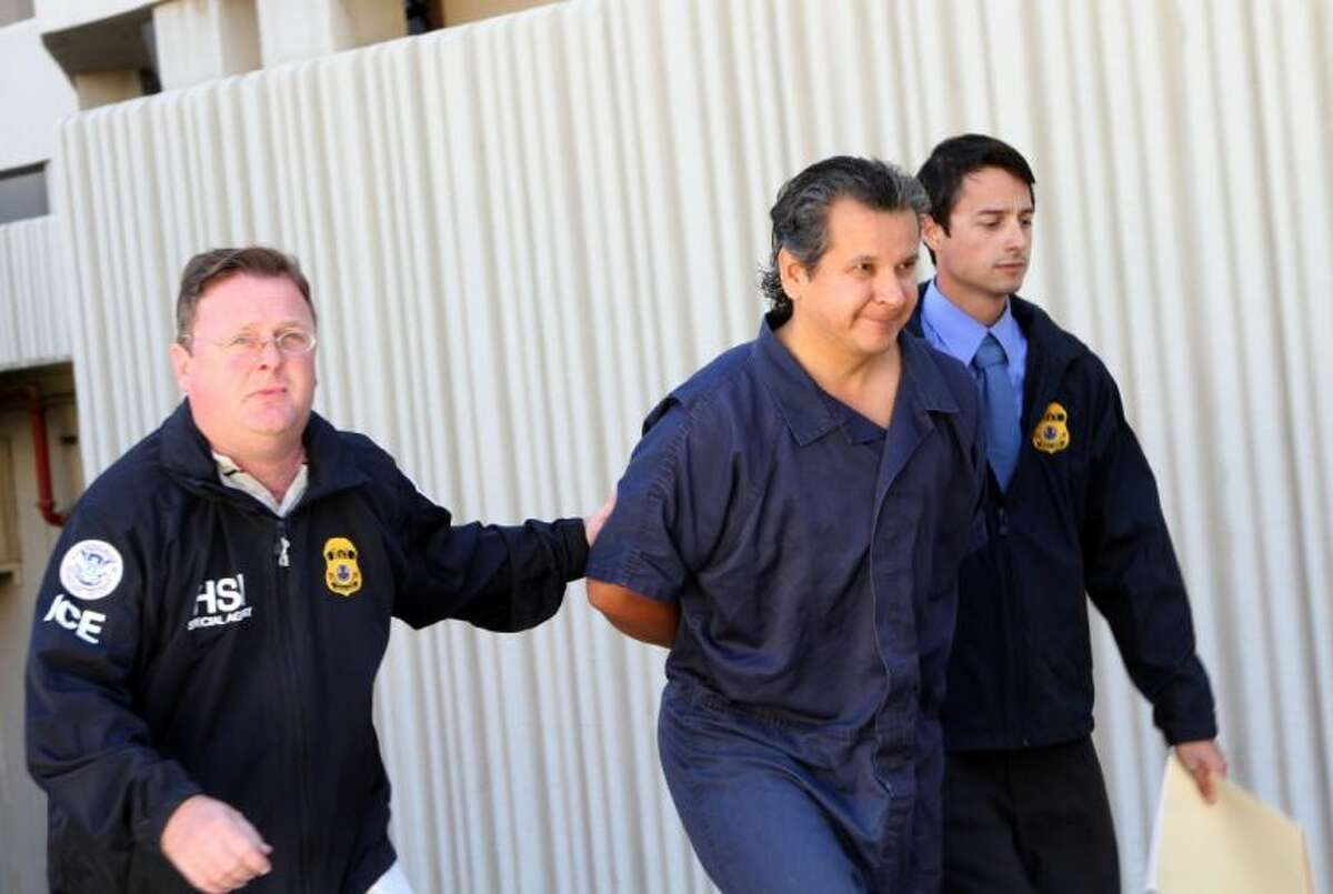 In this Nov. 5, 2012 file photo, El Paso lawyer and philanthropist Marco Antonio Delgado is escorted out of the El Paso County Jail in El Paso, Texas. An indictment filed Wednesday in Texas alleges that Delgado defrauded a firm doing business with a Mexican utility of millions and used that money to underwrite a lavish lifestyle that included a 250,000 contribution to Carnegie Mellon University.