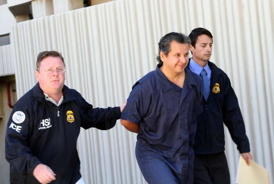 In this Nov. 5, 2012 file photo, El Paso lawyer and philanthropist Marco Antonio Delgado is escorted out of the El Paso County Jail in El Paso, Texas. An indictment filed Wednesday in Texas alleges that Delgado defrauded a firm doing business with a Mexican utility of millions and used that money to underwrite a lavish lifestyle that included a 250,000 contribution to Carnegie Mellon University. Photo: Juan Carlos Llorca