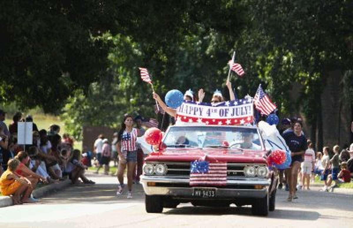 Classic cars and decorative floats make their way down the route during the Walden Property Owners Association's annual Independence Day Parade held Thursday morning in Walden. To view or order this photo and others like it, visit HCNPics.com.