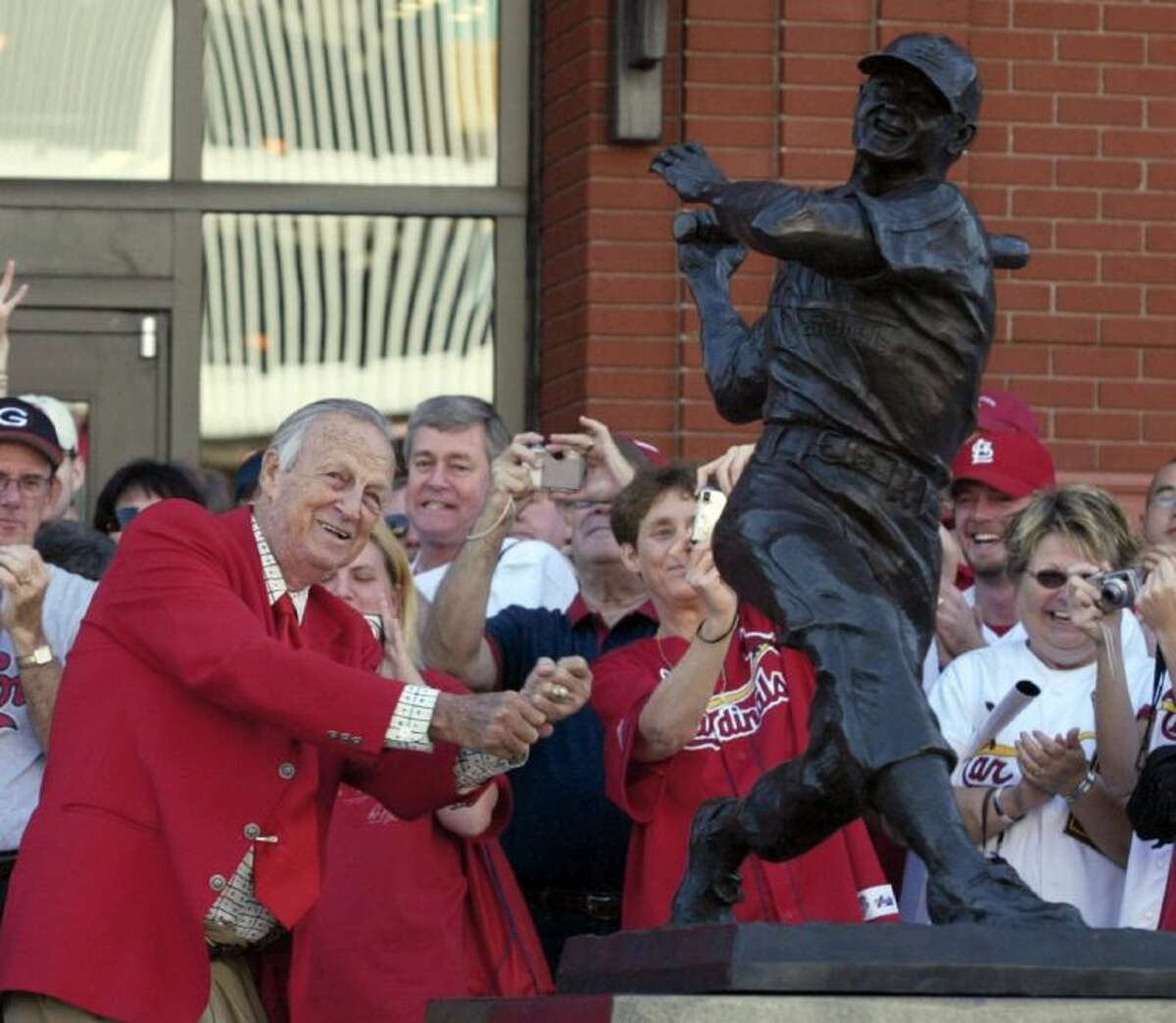 Stan Musial poses with a statue of his likeness outside Busch Stadium in 2006. The Hall of Fame outfielder died Saturday at age 92.