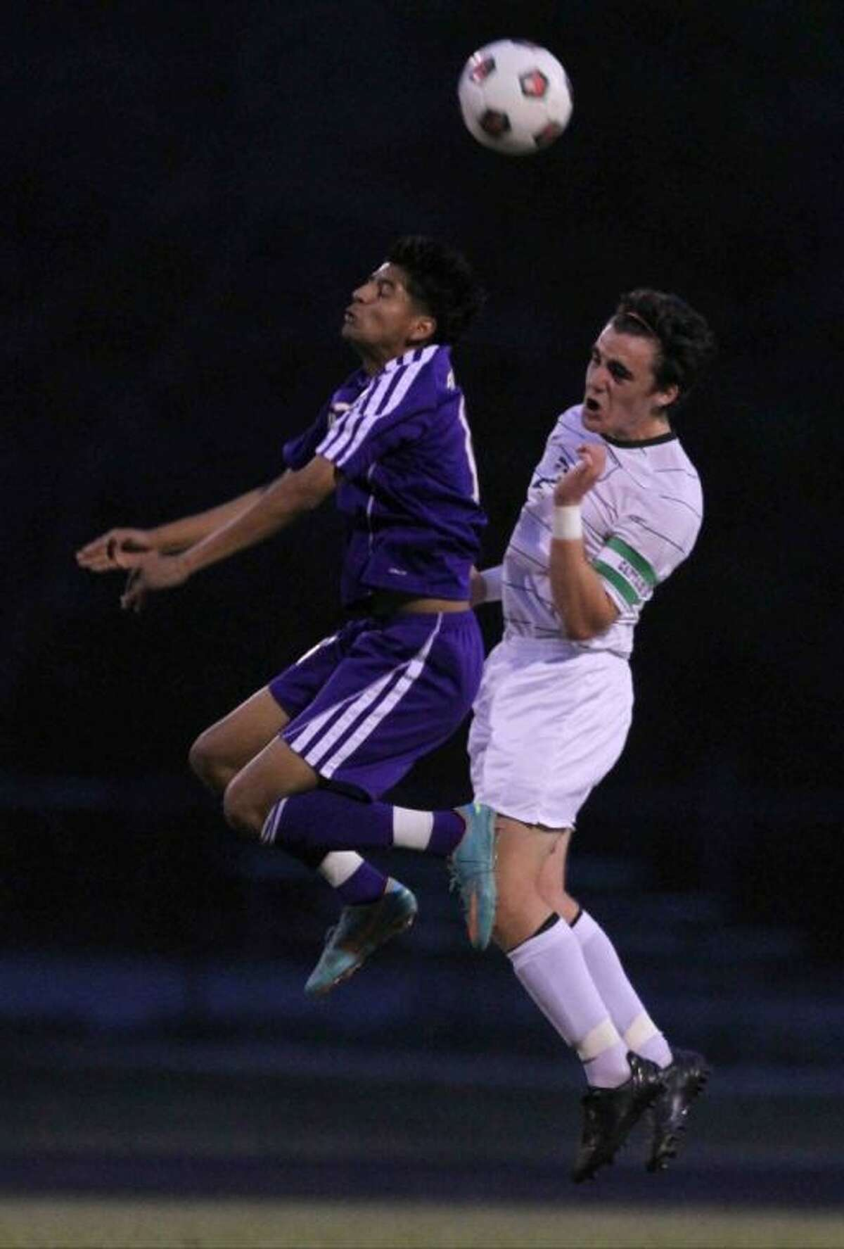 The Woodlands midfielder Vincent Miller goes up for a header during Friday's match against Lufkin at The Woodlands High School. To view or purchase this photo and others like it, visit HCNpics.com.