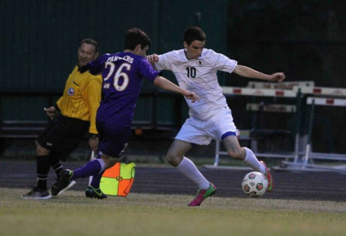 The Woodlands forward Johannus Cuarezma fights off a defender during Friday's match against Lufkin. To view or purchase this photo and others like it, visit HCNpics.com.