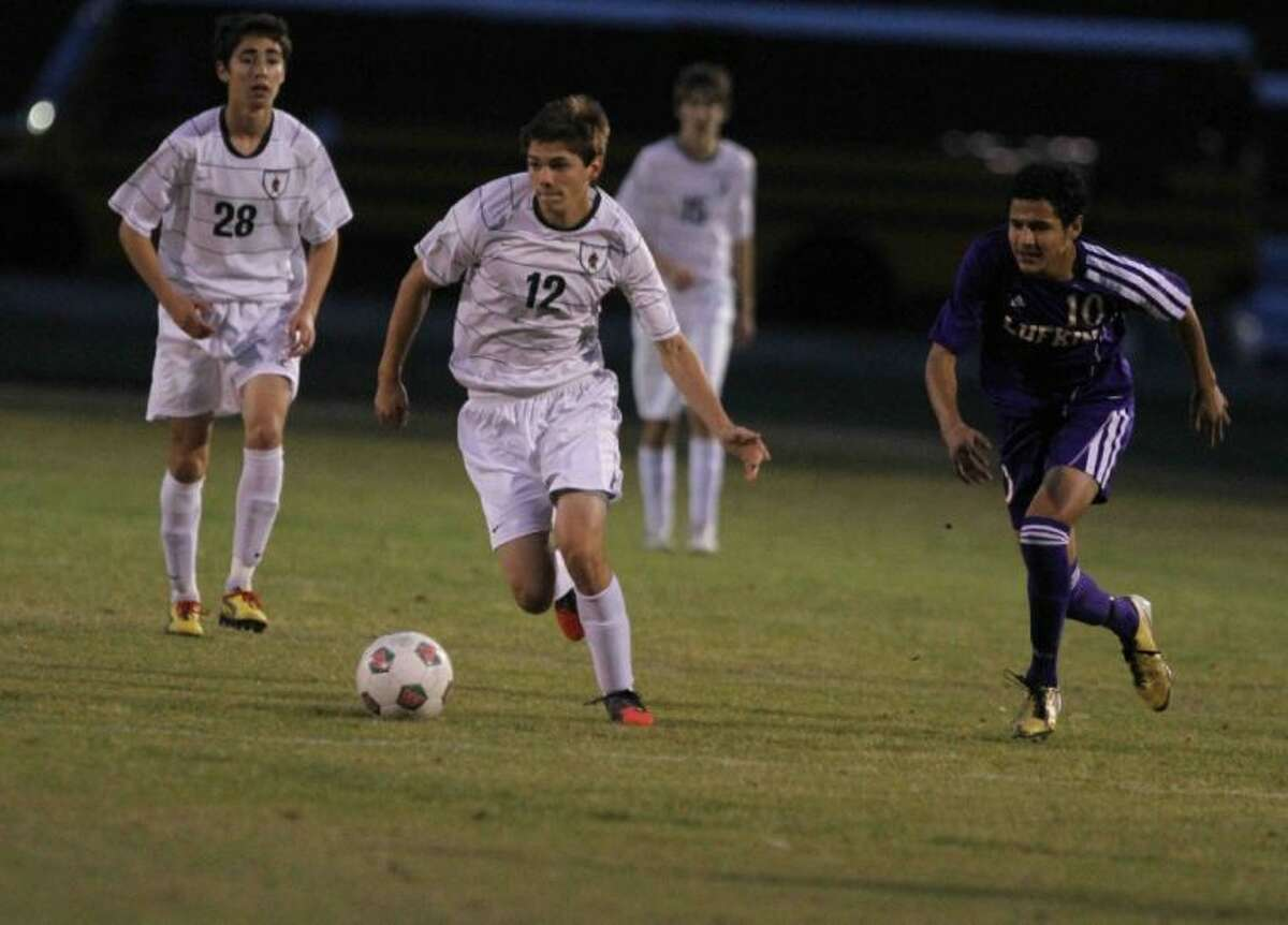 The Woodlands forward Mark Sukalski dribbles the ball downfield during Friday's match at The Woodlands High School. To view or purchase this photo and others like it, visit HCNpics.com.