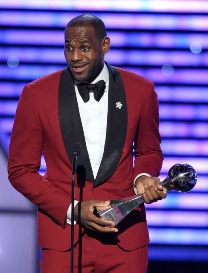 LeBron James accepts the trophy for best male athlete at the ESPY Awards on Wednesday at the Nokia Theater in Los Angeles. Photo: John Shearer
