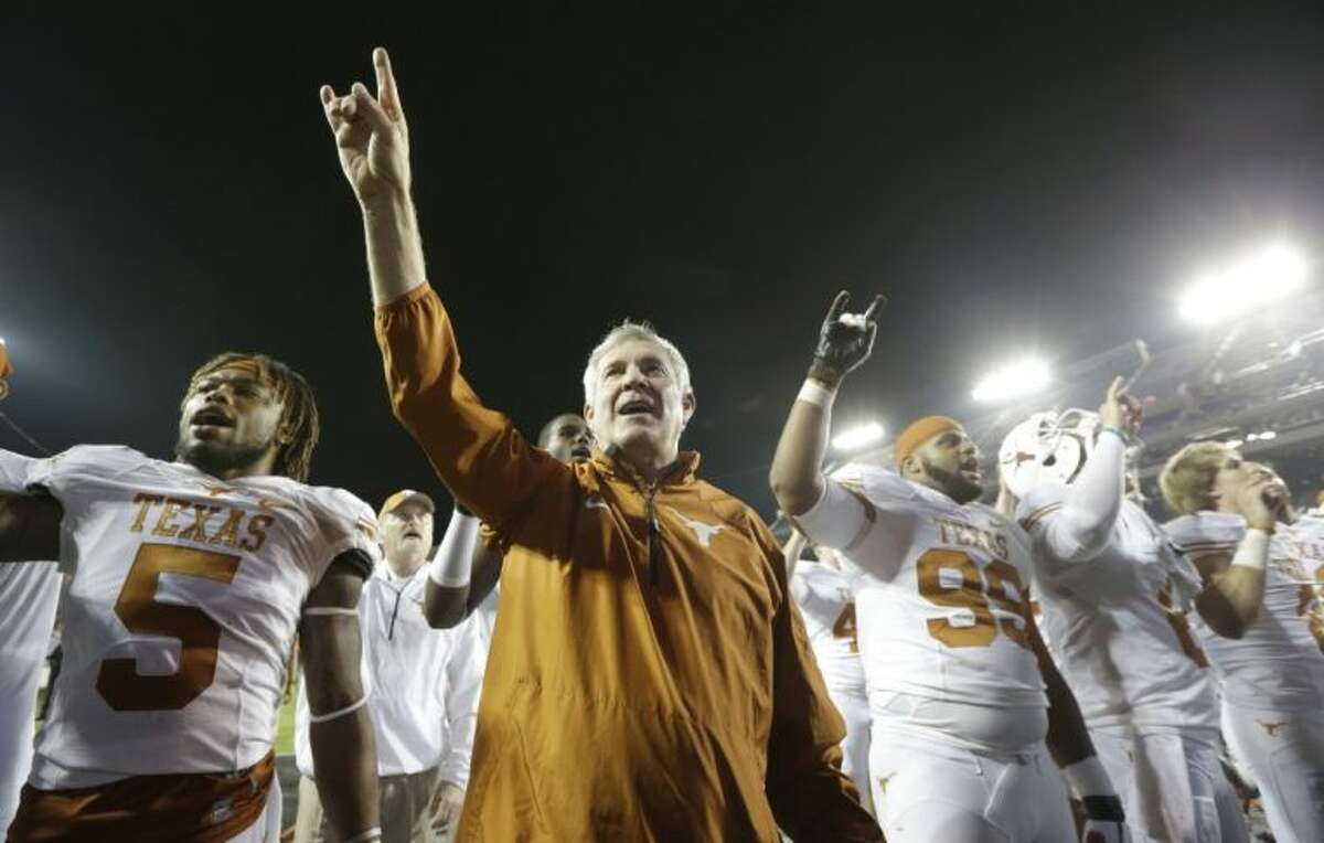 Texas coach Mack Brown and his players salute the crowd that stuck around for the 30-7 win over TCU.