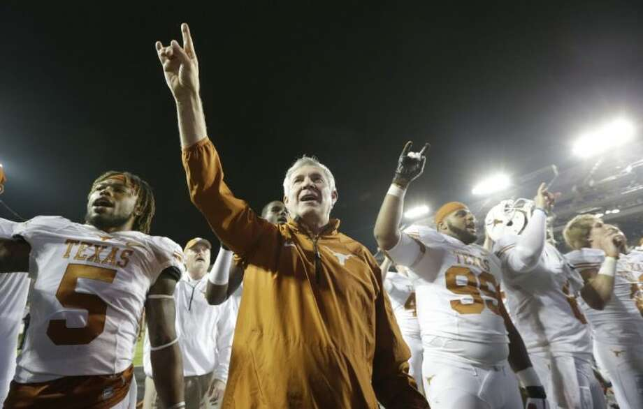 Texas coach Mack Brown and his players salute the crowd that stuck around for the 30-7 win over TCU. Photo: LM Otero