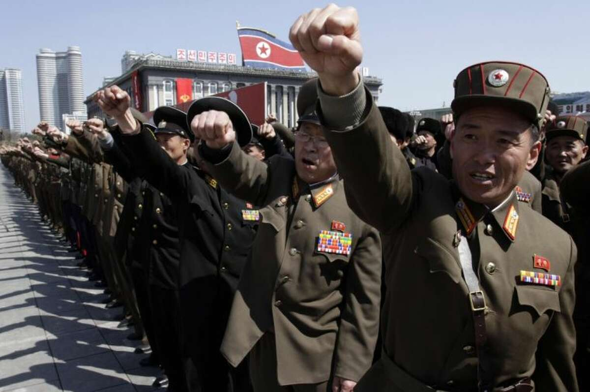 North Korean army officers punch the air as they chant slogans during a rally at Kim Il Sung Square in downtown Pyongyang, North Korea, Friday. Tens of thousands of North Koreans turned out for the mass rally at the main square in Pyongyang in support of their leader Kim Jong Un's call to arms.