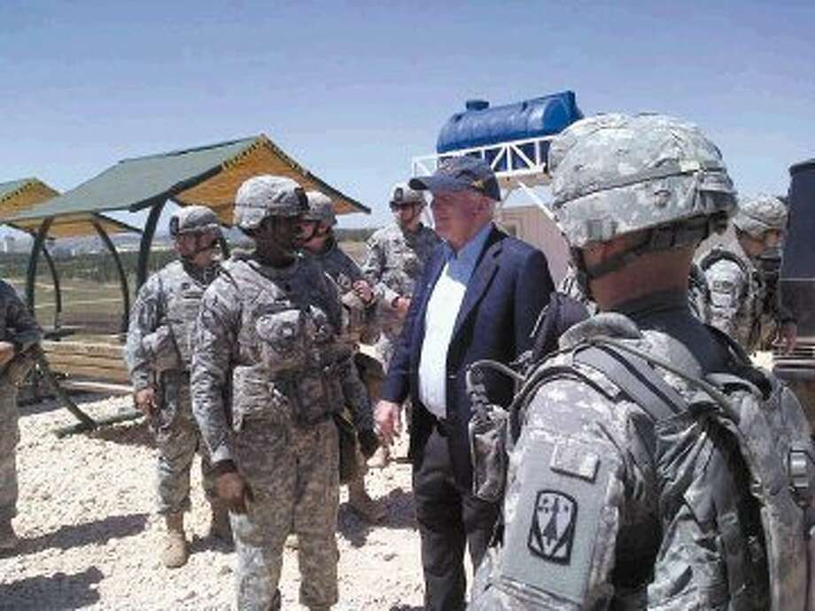 In this photo provided by U.S. Sen. John McCain, R-Ariz., on his Twitter site, McCain visits troops at a Patriot missile site in southern Turkey, Monday. McCain quietly slipped into Syria for a meeting with Syrian rebels on Monday, confirms spokeswoman Rachael Dean. She declined further comment about the trip. Photo: HOPD / U.S. Sen. John McCain via Twitter