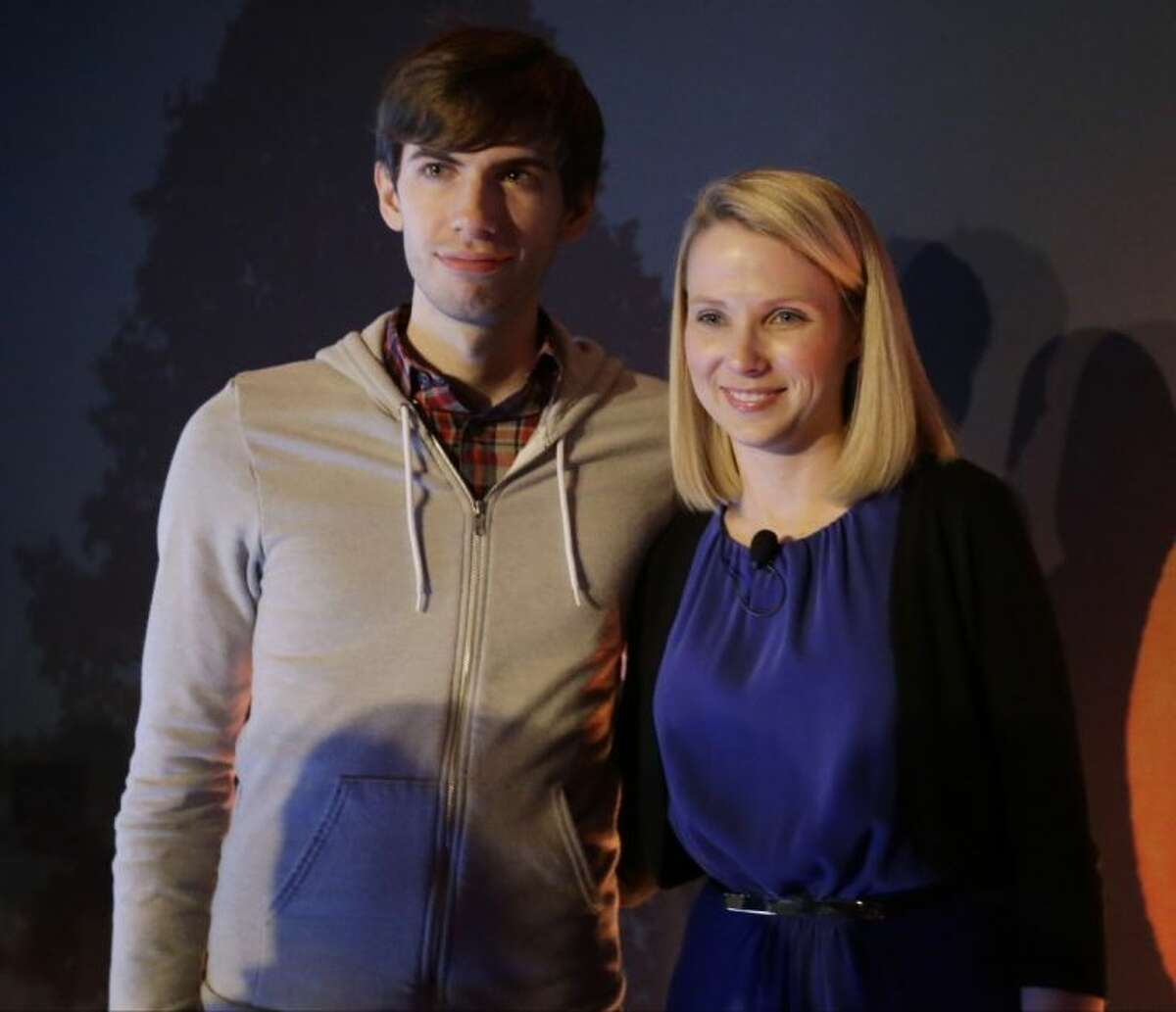Yahoo CEO Marissa Mayer, and Tumblr Chief Executive David Karp speak during a news conference Monday in New York. Yahoo edged up 31 cents, or 1.2 percent, to 26.83 after the Internet company said it was buying online blogging forum Tumblr for 1.1 billion.