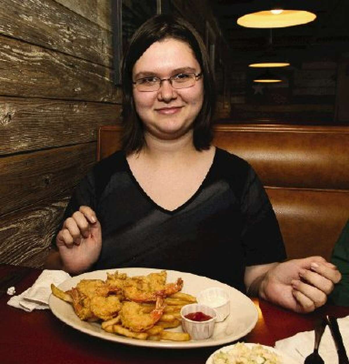 For her final meal as a summer intern at The Courier, Elizabeth Evans had a fried shrimp plate at Poppy's Seafood Grille in Willis.