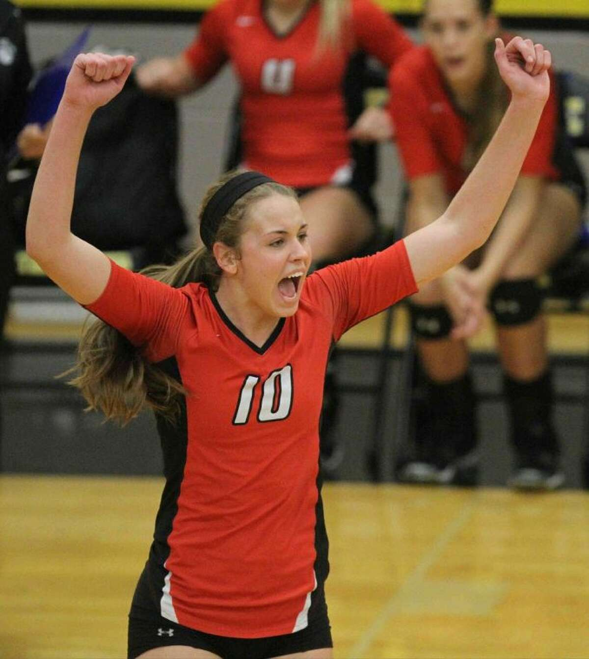 Oak Ridge's Victoria Harris celebrates a point against Conroe on Tuesday. To view or purchase this photo and others like it, visit HCNpics.com.