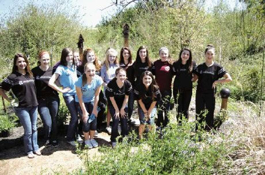 Eighth Grade girls from the Montgomery Chapter of The National Charity League spent Sunday, March 24 at Memory Park, planting lots of new flowers in The Rainbow Bridge Garden.