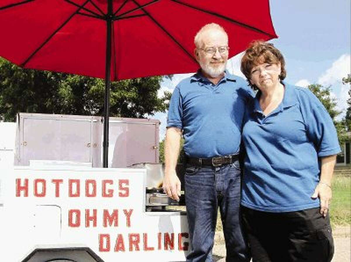 Andy and Susan Bryan, owners of Oh My Darling Hot Dogs, are ready to make their hot dog cart a lunch destination for pedestrians in downtown Conroe.