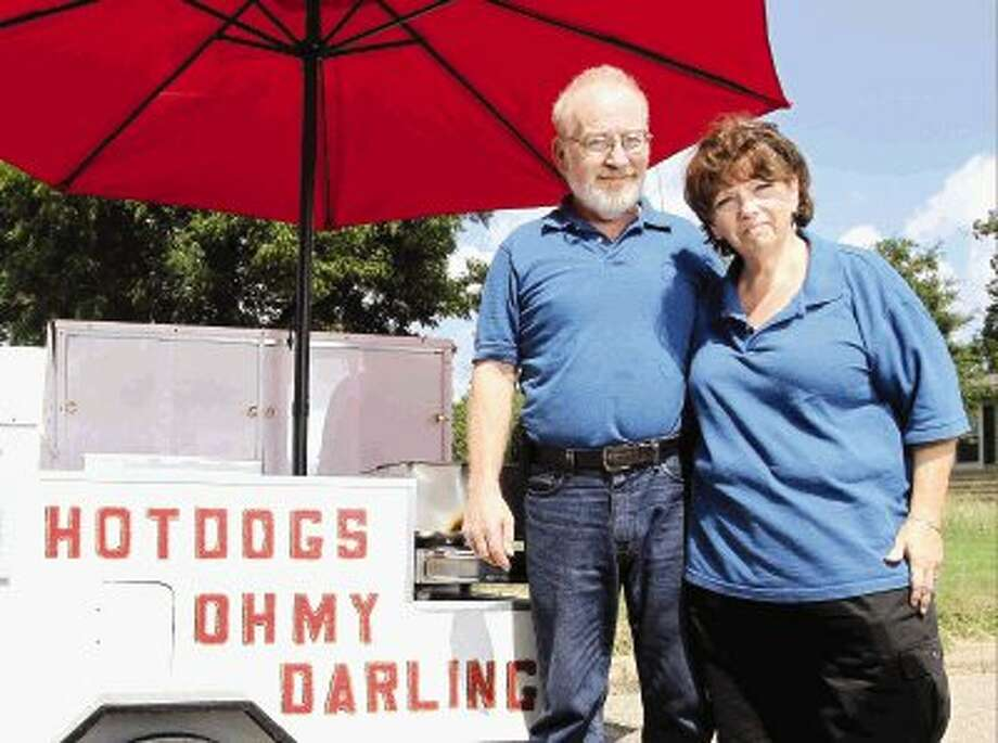 Andy and Susan Bryan, owners of Oh My Darling Hot Dogs, are ready to make their hot dog cart a lunch destination for pedestrians in downtown Conroe. Photo: Staff Photo By Jason Fochtman
