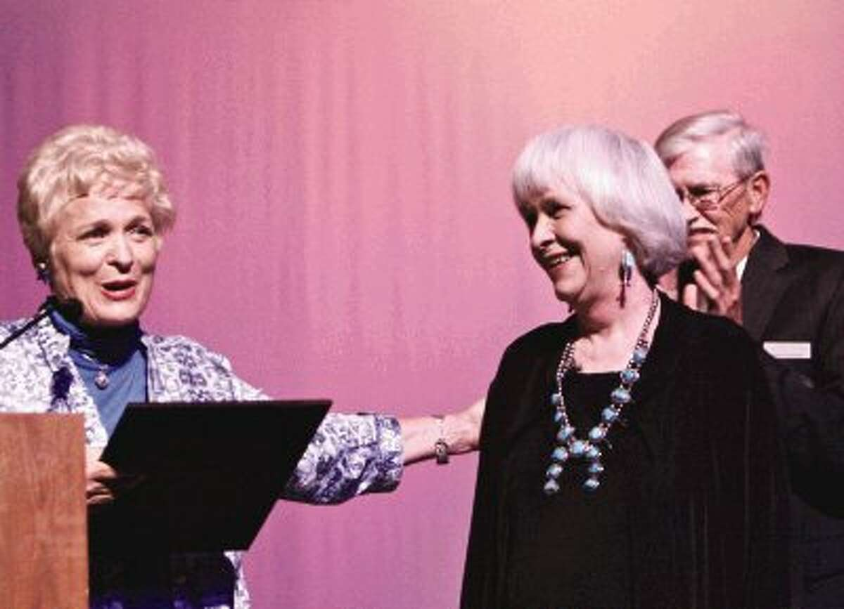 Peggy Miller, right, smiles as she is presented with a Special Senatorial Certificate from State Senator Robert Nichols by Luine Hancock, left, before the start of the Larry Gatlin concert Saturday at the Crighton Theatre in Conroe. Miller received the certificate in honor and recognition of her leadership, public service and many lifetime achievements. To view or order this photo and others like it, visit HCNPics.com.