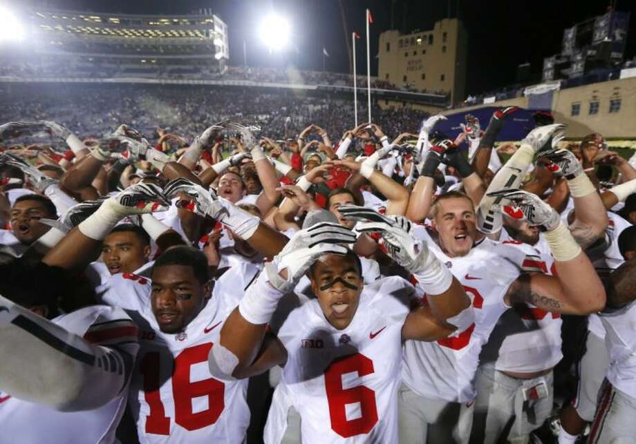 Ohio State players celebrate a 40-30 win over Northwestern on Oct. 5 in Evanston, Ill. Photo: Charles Rex Arbogast