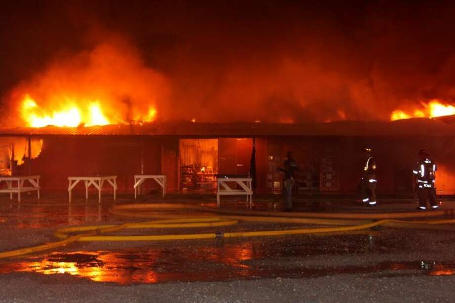 Fire consumes a wood-framed building that is part of The Trading Place flea market in Cleveland. The fire, which started around 3 a.m., Sept. 16, destroyed a building that housed more than 20 vendor booths. Photo: VANESA BRASHIER