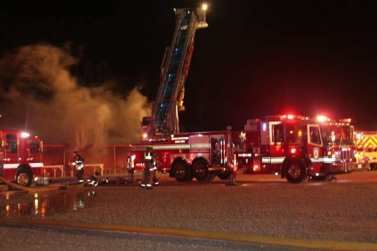 Fire consumes a wood-framed building that is part of The Trading Place flea market in Cleveland. The fire, which started around 3 a.m., Sept. 16, destroyed a building that housed more than 20 vendor booths.