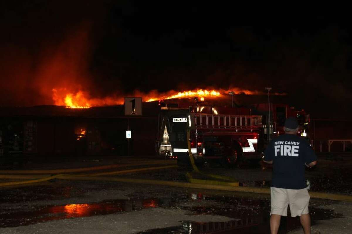 Fire departments from as far away as Magnolia, Conroe and New Caney responded to a four-alarm blaze around 3 a.m., Sept. 16, at The Trading Place flea market in Cleveland.