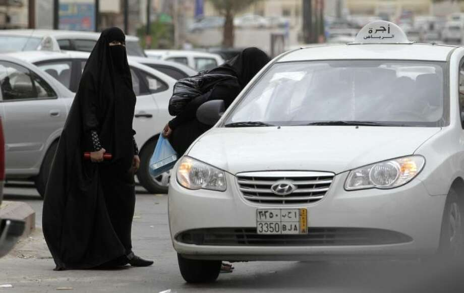 In this file photo taken May 24, 2011, Saudi women board a taxi in Riyadh, Saudi Arabia. A campaign calling on women to drive on Saturday has started gathering support online and already has nearly 15,000 signatures.