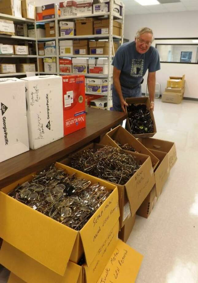 Lion Bob Gunter sorts used eyeglasses donated to the Conroe Noon Lions Club Eyeglass Recycling Center.