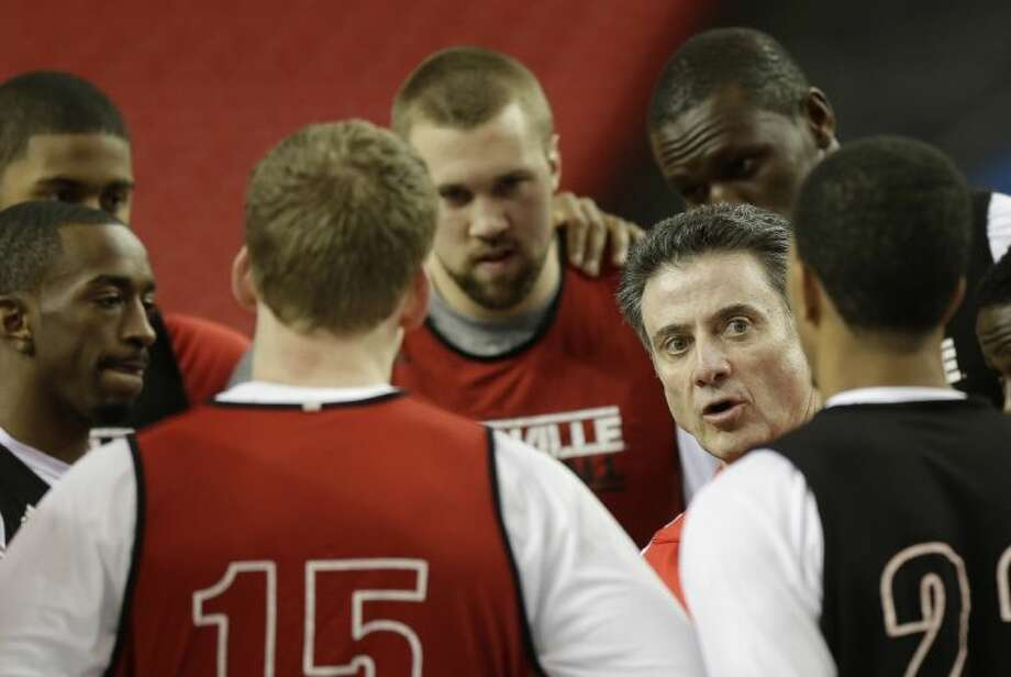 Louisville coach Rick Pitino chats with his players at Friday's practice. The Cardinals face Wichita State tonight in the Final Four. Photo: John Bazemore