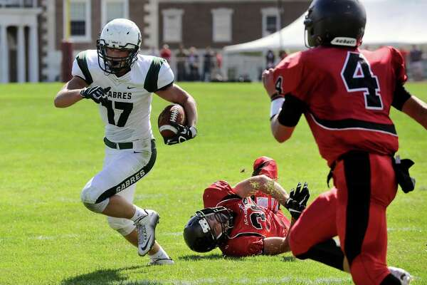 Schalmont's Tim Ryan (17) runs for a touchdown past Albany Academy's Kyle Jasenski (36) and Brett Young (4) during their Class B high school football game in Albany, N.Y., Saturday, Sept. 24, 2016. (Hans Pennink / Special to the Times Union) ORG XMIT: HP115